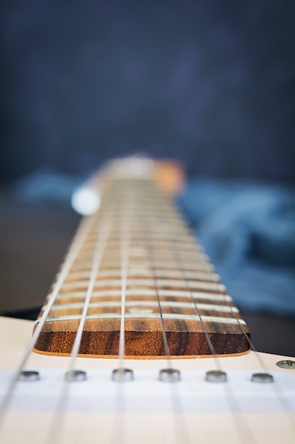 Close up of electric guitar on dark surface Premium Photo