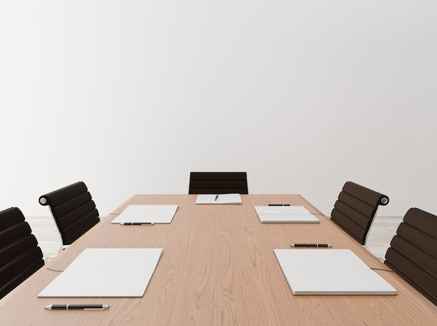 Close up empty meeting room with chairs, wooden table, notebook, concrete wall Premium Photo