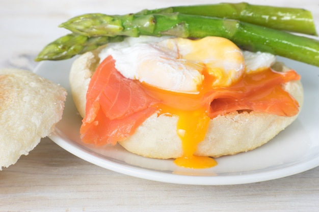 Close up of english muffin with poached egg Premium Photo