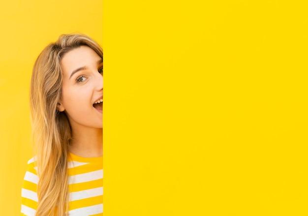 Close-up excited woman hiding Premium Photo