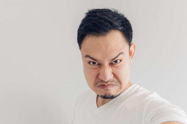 Close up face of angry man selfie himself. Premium Photo