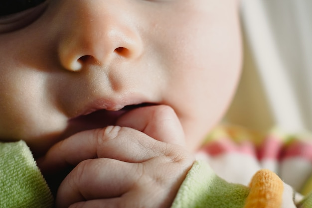 Close-up of the face of a worried baby, macro portrait. Premium Photo