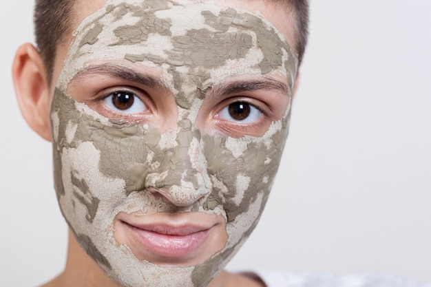 Close-up facial t=mud treatment applied Free Photo