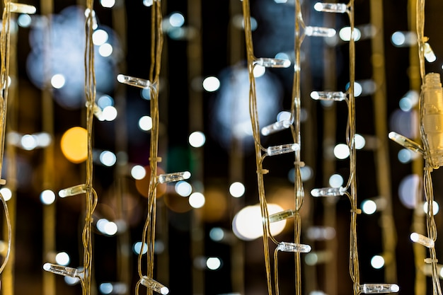 Close-up of fairy light against bokeh background Free Photo