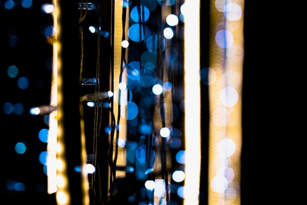 Close-up of fairy lights decoration with bokeh at night Free Photo