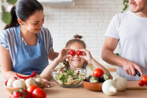 Close-up family cooking together Premium Photo