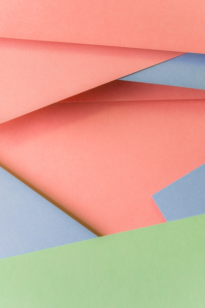 Close-up of fashionable pastel colored paper backdrop Free Photo