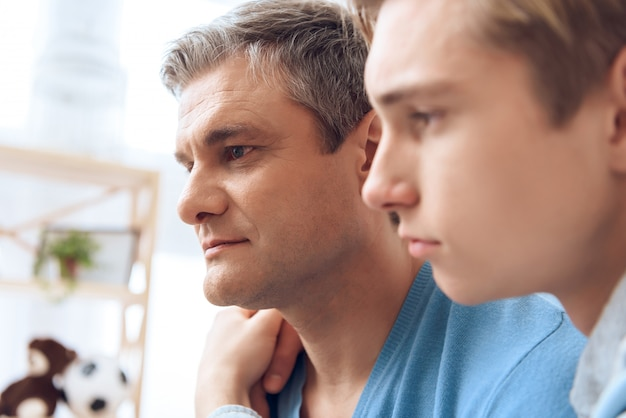 Close up father and son embrace each other Premium Photo