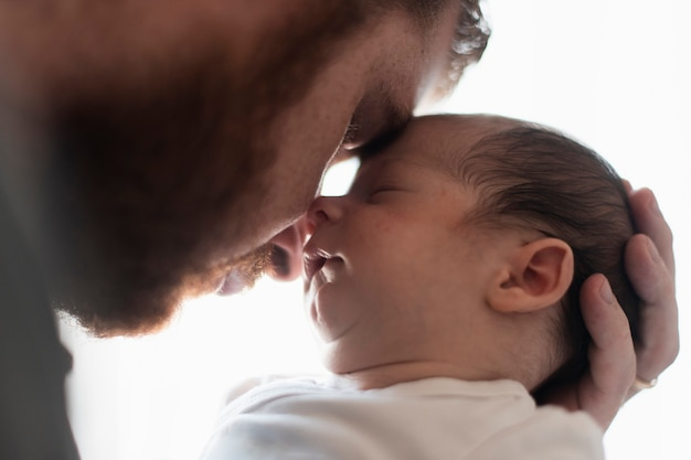 Close-up father and son having a moment Free Photo