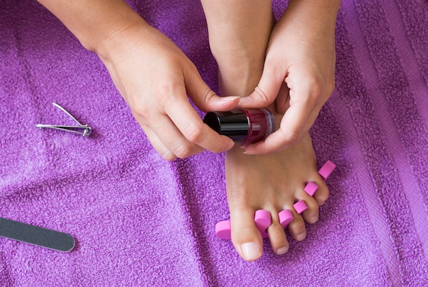 Close-up of a female feet having a beauty treatment pedicure for nails Premium Photo