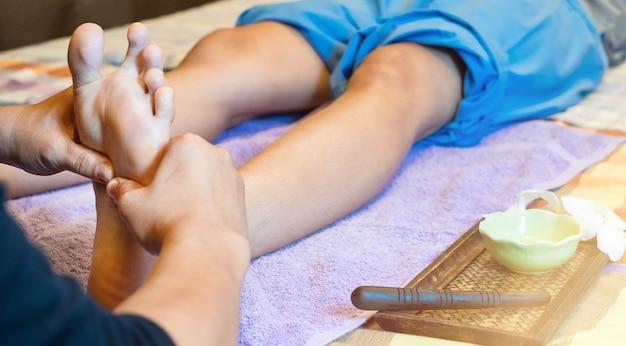 Close-up of female hands doing foot massage.foot massage Premium Photo
