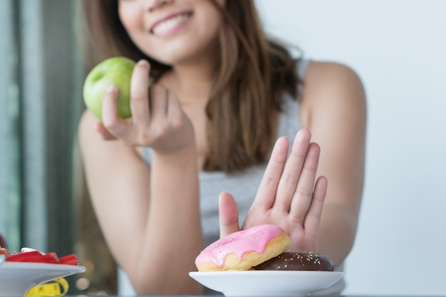 Close up female using hand choose green apple. Premium Photo