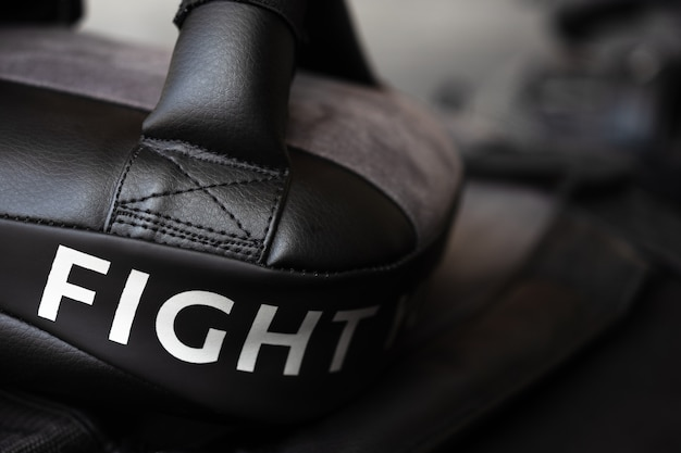 Close up of fight word on black boxing and kicking practice pad. Premium Photo