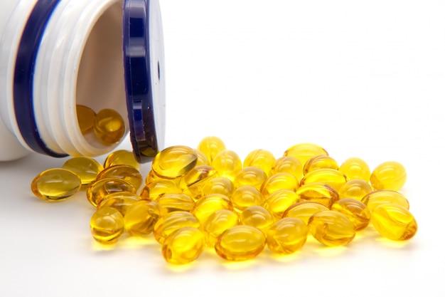 Close up fish oil capsules on white background. many gel capsules of vitamin d3 2000 iu on white background. Premium Photo