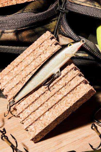 Close-up of fishing bait on cork board Free Photo