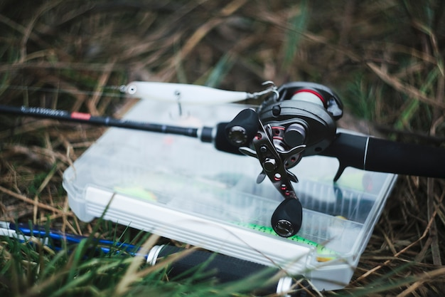 Close-up of fishing reel with lure Free Photo