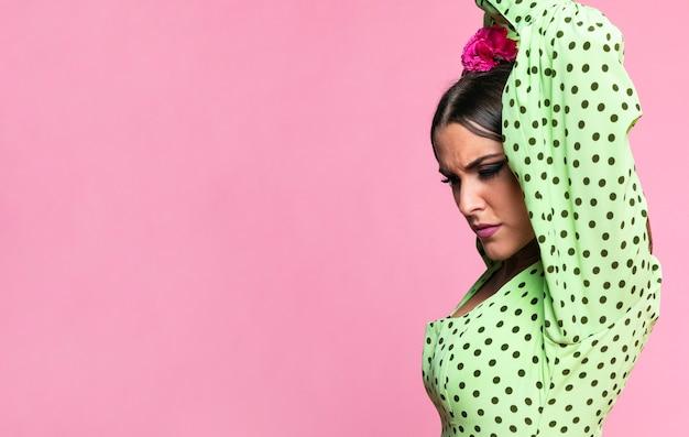 Close-up flamenca dancer looking down Free Photo