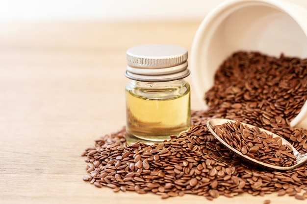 Close Up Flaxseed Essential Oil And Seeds In A Wooden Spoon Photo