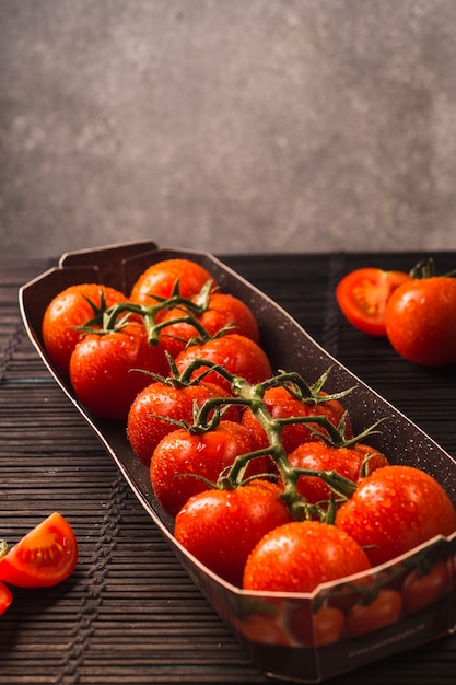 Close-up of fresh red tomatoes in tray Free Photo
