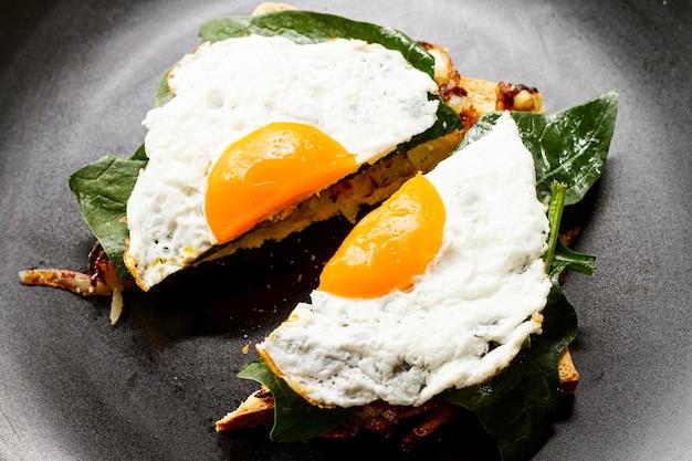 Close up fried egg on waffle Free Photo