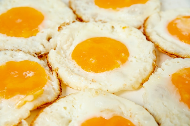 Close up fried eggs with high angle Free Photo