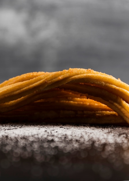 Close-up front view delicious churros on a blanket of sugar Free Photo