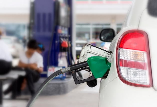 Close up of fuel monitoring system refueling a petroleum to vehicle at gas station. Premium Photo