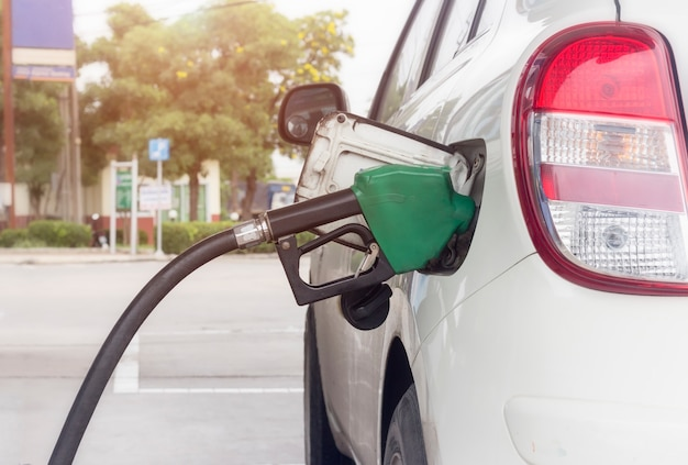 Close up of fuel monitoring system refueling a petroleum to vehicle at gas station Premium Photo