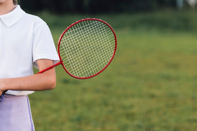 Close-up of a girl holding badminton in the park Free Photo