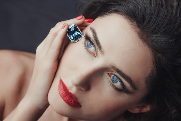 Close-up girl and sapphire Premium Photo