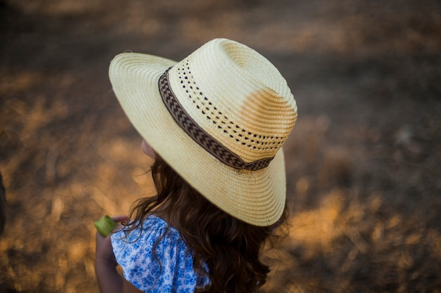 Close-up of a girl wearing straw hat Free Photo