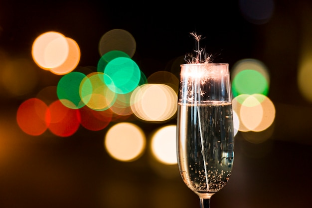 Close-up of glass of champagne with firework Free Photo