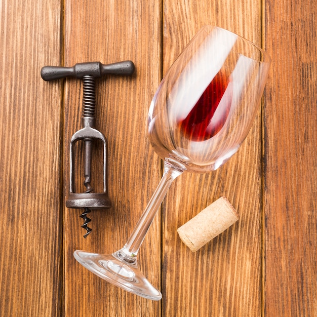 Close up glass of red wine on wooden background Free Photo