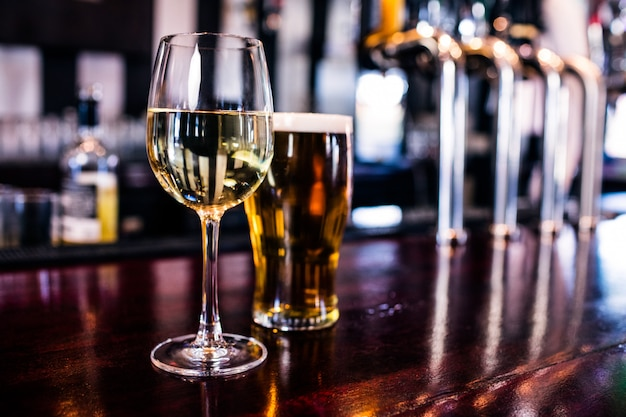 Close up of a glass of wine and a beer in a bar Premium Photo