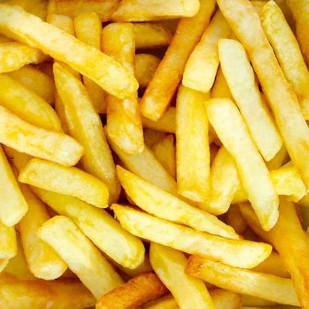 Close-up of golden french fries Free Photo