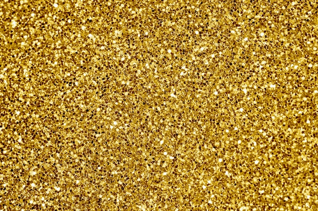 Close up of golden glitter textured background Free Photo