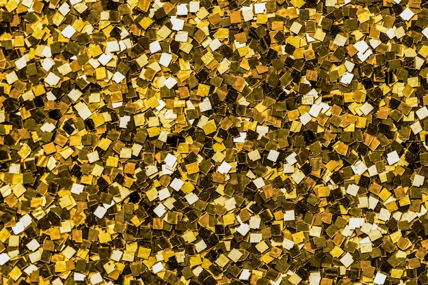Close up of golden sequin background Free Photo