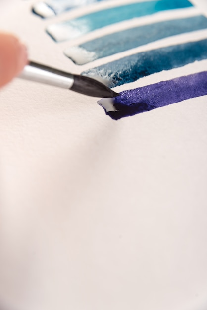 Close up of gradient blue stripes on white paper Free Photo