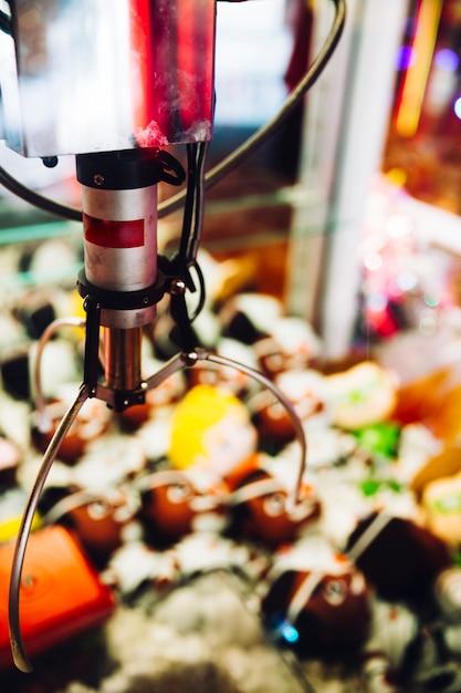 Close-up grappling hook arcade machine Free Photo