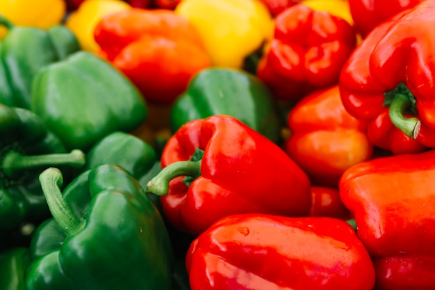 Close-up of green and red bell pepper Free Photo