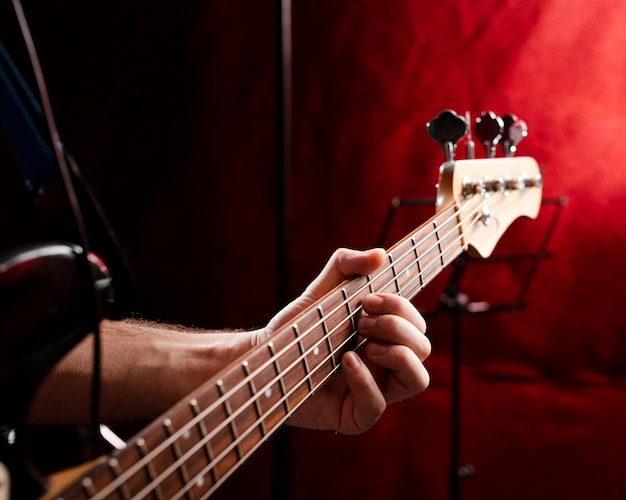 Close-up grif with strings of an electric guitar in the studio Free Photo