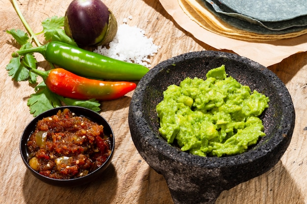 Close-up guacamole and salsa for tortilla Free Photo
