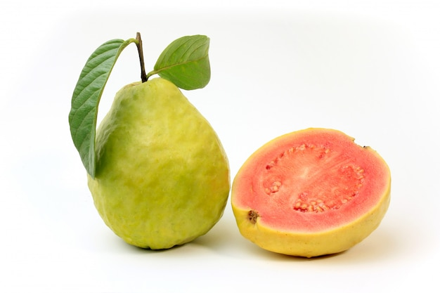 Close-up guava fruit, pink, fresh, organic, with leaves, whole and sliced, isolated on white background. front view Premium Photo