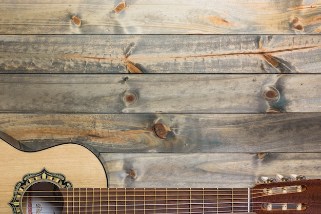 Close-up of guitar on wooden table Free Photo