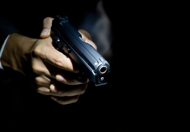 Close up gunman on dark  background Premium Photo