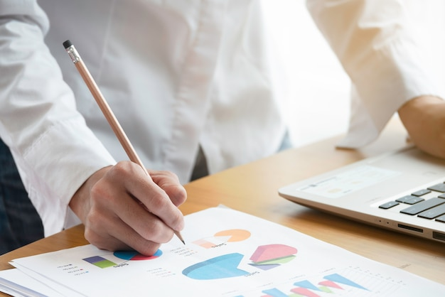 Close up hand of businesswoman working with business data, and document. Premium Photo