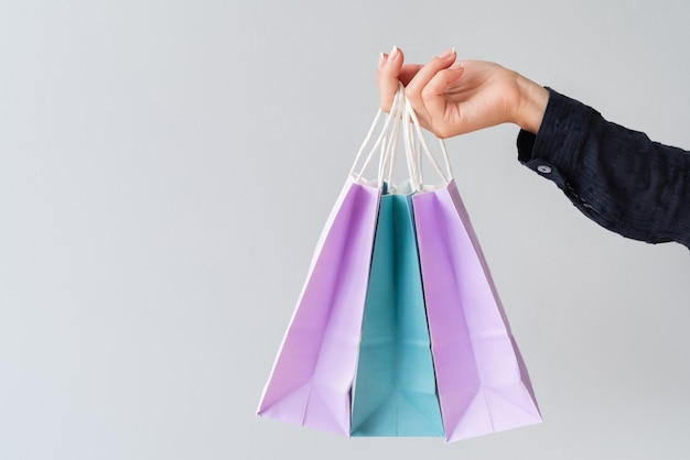 Close-up of hand holding gift bags Free Photo