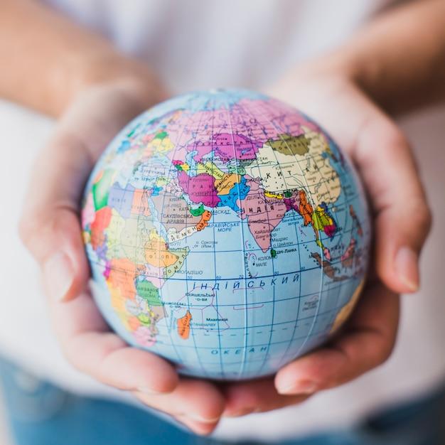 Close-up of hand holding globe Premium Photo
