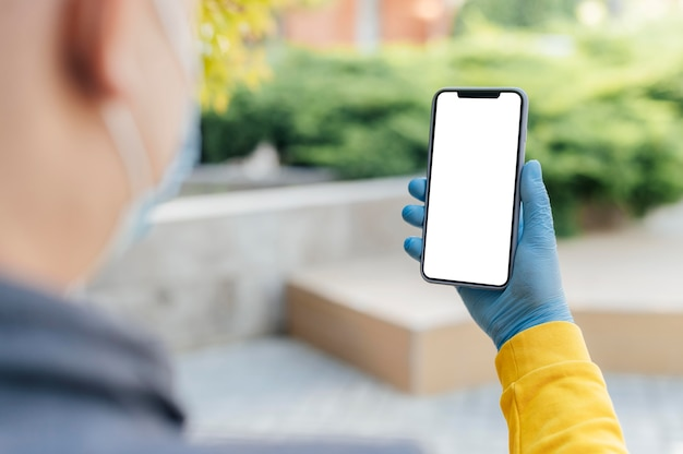 Крупным планом рука смартфон Premium Фотографии