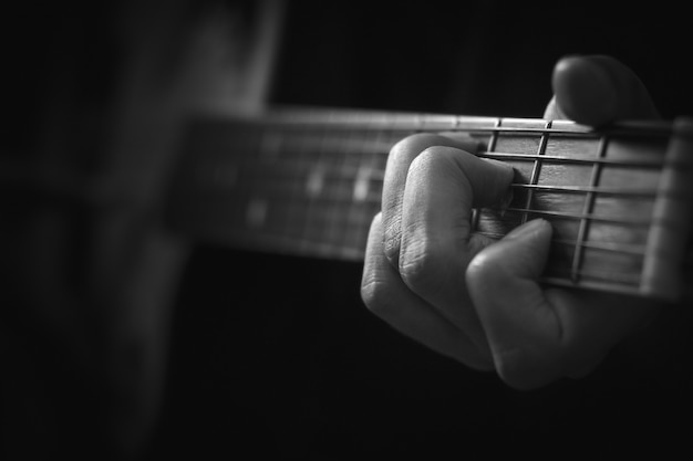 Close up of hand playing acoustic guitar background. Premium Photo